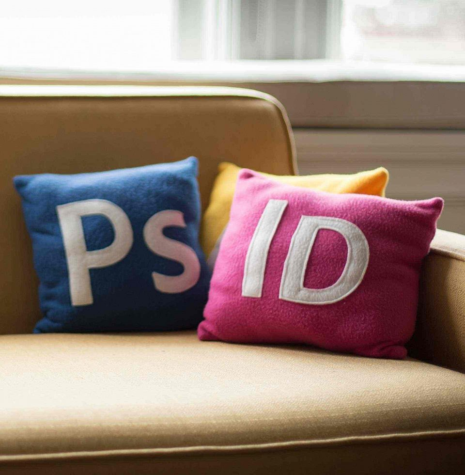 Three pillows on a couch that resemble icons from design software.