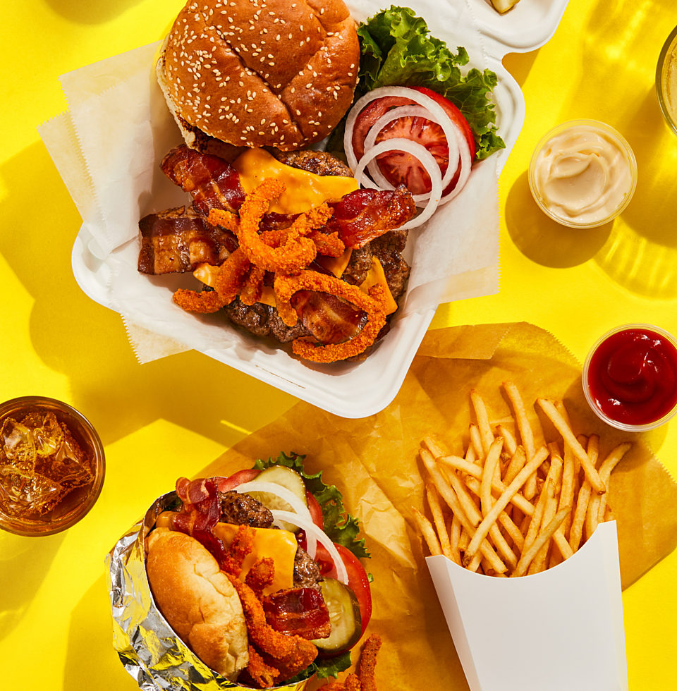 A variety of delicious takeout foods, presented nicely on a table.