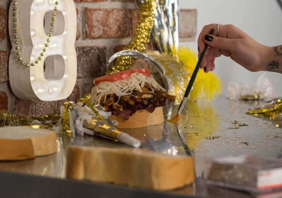 A food stylist at Smiths Agency working on a sandwich for a social media campaign.
