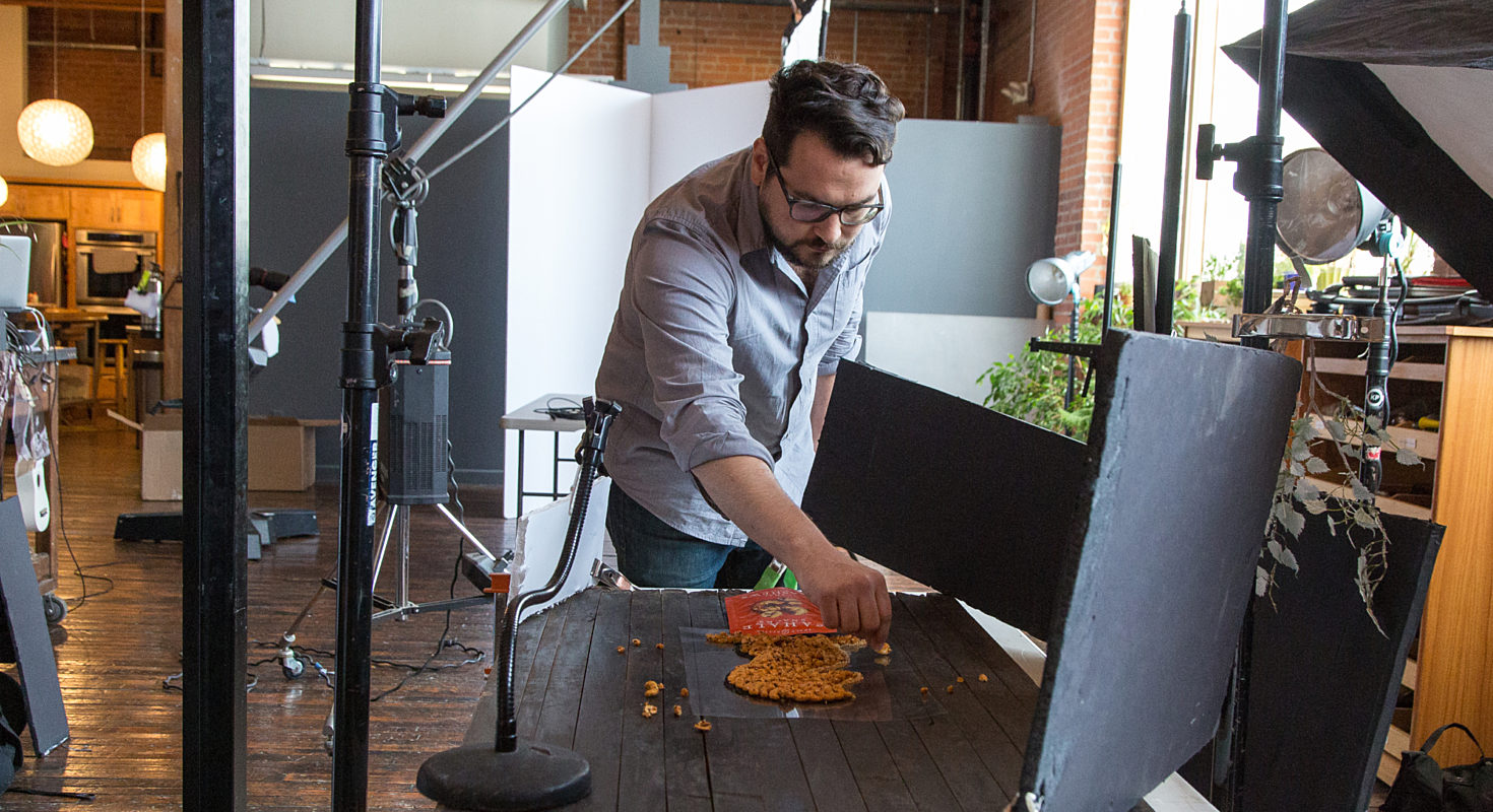 An employee of Smiths Agency designs a food shot for a video production.
