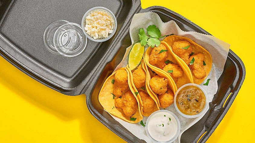 An open takeout container with tacos made from breaded cauliflower from McCain Foodservice.