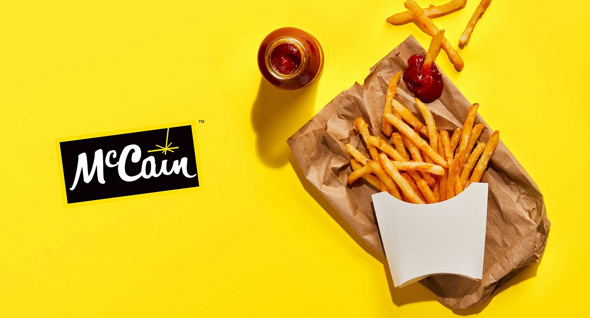 McCain Foodservice logo and a carton of fresh french fries.