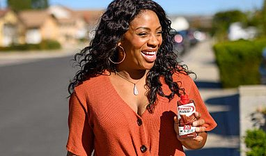 Charmaine walking with a Premier Protein drink, photographed by Smiths Agency.