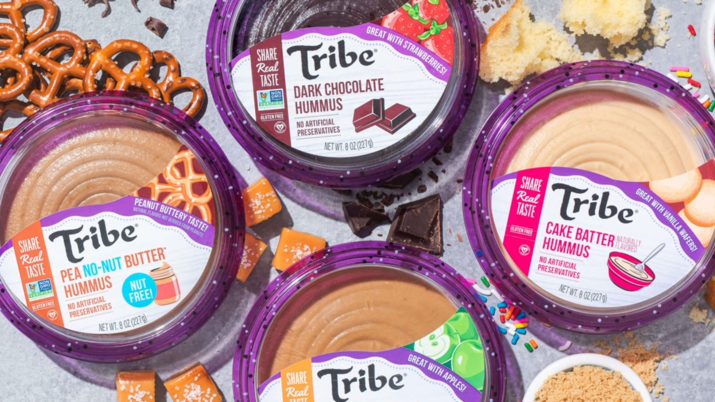 A variety of Tribe Hummus on a table.